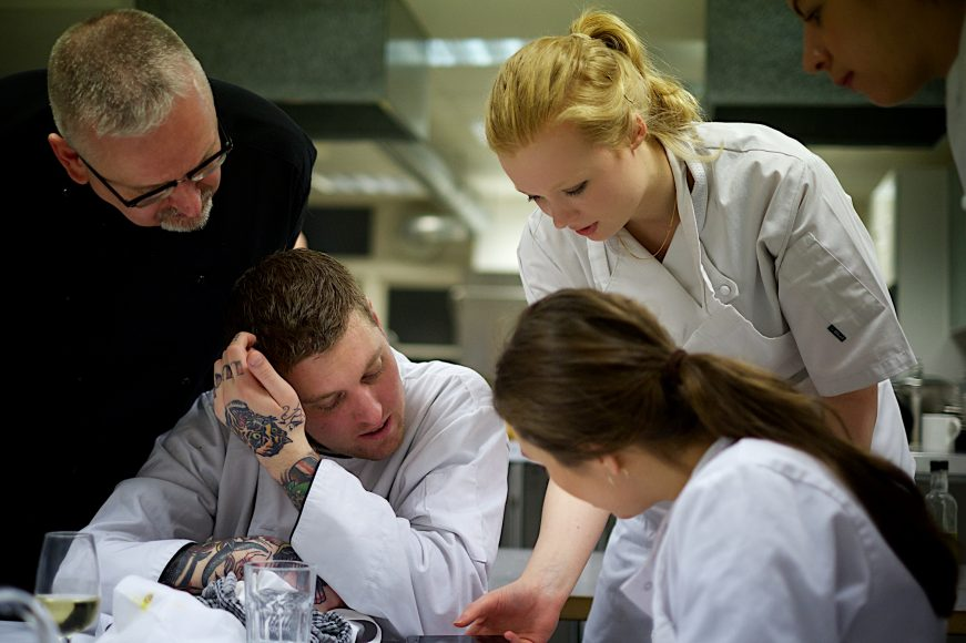 Above, students working at the Cook's Certificate Class at the Cookery School, London.